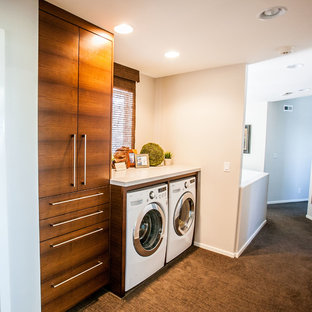Design ideas for a large modern single-wall utility room in Salt Lake City with an utility sink, flat-panel cabinets, granite worktops, white walls, carpet, a side by side washer and dryer and dark wood cabinets.