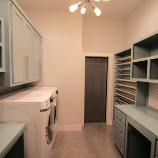 Inspiration for a large classic galley utility room in Other with shaker cabinets, blue cabinets, wood worktops, beige walls, concrete flooring, a side by side washer and dryer, grey floors and blue worktops.