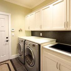 Traditional Laundry Room by Lacey Construction Ltd.
