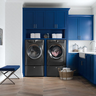 Laundry room - southwestern laundry room idea in New York with white countertops