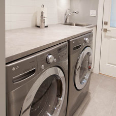 Contemporary Laundry Room by Kenorah Design + Build Ltd.