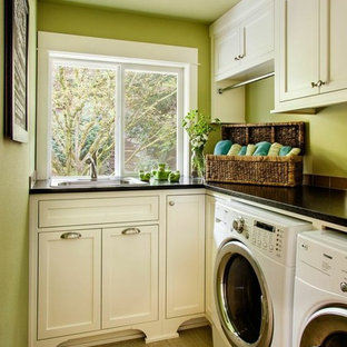 Example of a small classic l-shaped ceramic floor laundry room design in Portland with a drop-in sink, shaker cabinets, white cabinets, green walls, a side-by-side washer/dryer and soapstone countertops