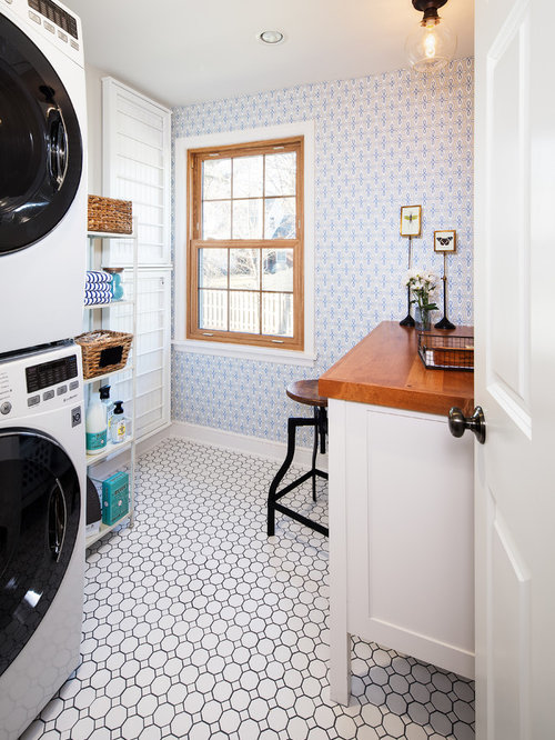 Example Of A Classic Single Wall Dedicated Laundry Room Design In Omaha With White Cabinets