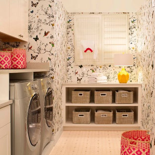Dedicated laundry room - transitional beige floor dedicated laundry room idea in Denver with multicolored walls and a side-by-side washer/dryer