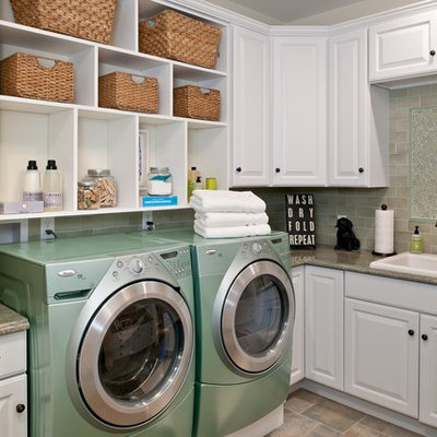 Inspiration for a timeless laundry room remodel in New York with white cabinets, a side-by-side washer/dryer, beige countertops and gray walls