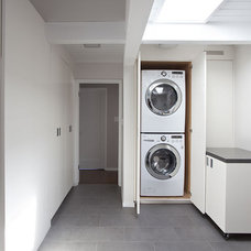 Midcentury Laundry Room by Klopf Architecture