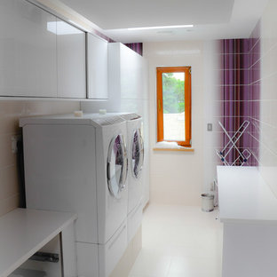 Inspiration for a contemporary galley dedicated laundry room remodel in Toronto with a side-by-side washer/dryer