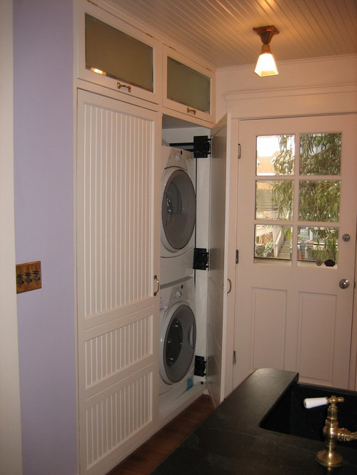 Laundry room - traditional laundry room idea in Los Angeles & Flipper Doors | Houzz
