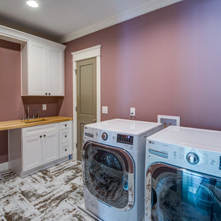 Design ideas for a large traditional single-wall separated utility room in Atlanta with a submerged sink, shaker cabinets, white cabinets, wood worktops, a side by side washer and dryer, white floors, beige worktops and purple walls.