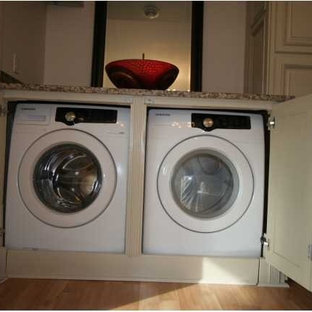 Laundry room - contemporary laundry room idea in Other
