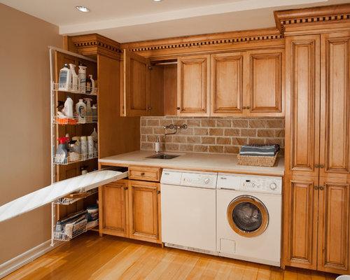 buanderie avec des portes de placard marrons photos et id es d co de buanderies. Black Bedroom Furniture Sets. Home Design Ideas