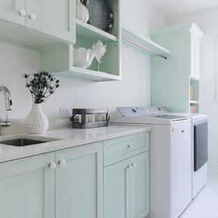 Example of a beach style laundry room design in Chicago