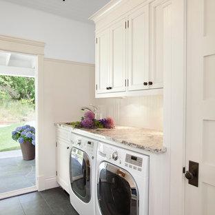 Idéer för en klassisk beige tvättstuga, med luckor med infälld panel, beige skåp, en tvättmaskin och torktumlare bredvid varandra och svart golv