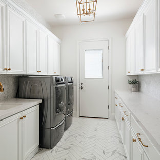 Inspiration for a large transitional galley marble floor and white floor dedicated laundry room remodel in Phoenix with an undermount sink, raised-panel cabinets, white cabinets, quartz countertops, white walls, a side-by-side washer/dryer and white countertops