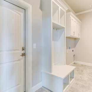 Laundry room - mid-sized transitional laundry room idea in Dallas