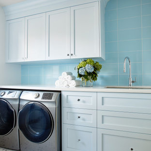 Large classic galley utility room in Toronto with blue cabinets, engineered stone countertops and white worktops.