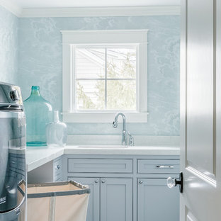 This is an example of a country dedicated laundry room in Boston with an undermount sink, quartz benchtops, ceramic floors, a side-by-side washer and dryer and blue walls.