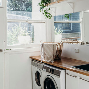 This is an example of a beach style laundry room in Wollongong.