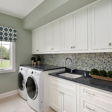 White Laundry Room with Blue and Green Accents, Custom Tile Backsplash,