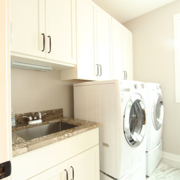 White painted cabinets used in compact laundry room