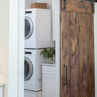 Inspiration for a mid-sized transitional single-wall dedicated laundry room remodel in Other with beaded inset cabinets, white cabinets and marble countertops