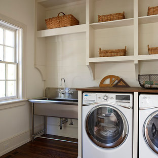 Laundry room - traditional laundry room idea in Other with wood countertops and brown countertops