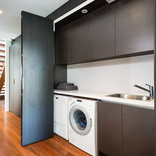Modern Laundry Room by Urban Kitchens