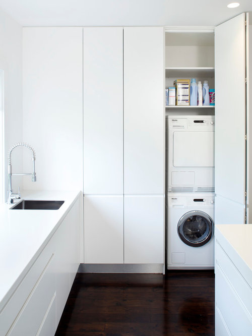 Minimalist Laundry Closet Photo In Sydney With A Stacked Washer Dryer And White Cabinets