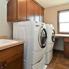 Traditional Laundry Room by Redstone Builders