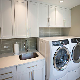 Utility room - mid-sized modern single-wall porcelain floor and beige floor utility room idea in Chicago with an undermount sink, shaker cabinets, white cabinets, solid surface countertops and gray walls