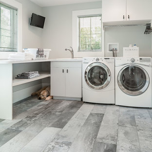 Inspiration for a large contemporary galley porcelain tile utility room remodel in New York with a drop-in sink, open cabinets, white cabinets, white walls and a side-by-side washer/dryer