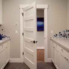 transitional laundry room by Interiors
