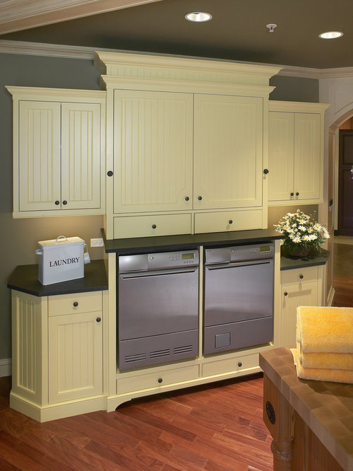 Best laundry room with yellow cabinets and solid surface for Adams cabinets perth