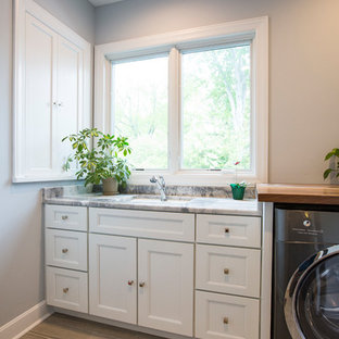 Inspiration for a large traditional l-shaped separated utility room in Cincinnati with a submerged sink, shaker cabinets, white cabinets, granite worktops, multi-coloured splashback, mosaic tiled splashback, medium hardwood flooring, brown floors and multicoloured worktops.
