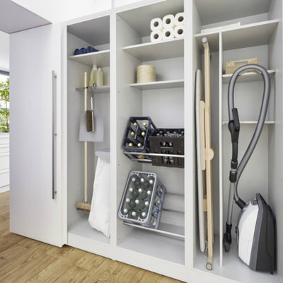Large trendy single-wall light wood floor and brown floor laundry room photo in Barcelona with flat-panel cabinets and white cabinets
