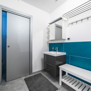 Design ideas for a large contemporary single-wall utility room in Other with a single-bowl sink, flat-panel cabinets, grey cabinets, solid surface benchtops, white walls, porcelain floors, a side-by-side washer and dryer, grey floor, white benchtop and exposed beam.