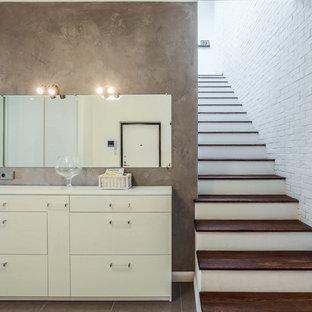 Пример оригинального дизайна интерьера: прямая лестница в современном стиле с деревянными ступенями