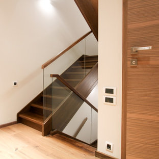 Example of a mid-sized trendy painted u-shaped staircase design in Moscow with painted risers