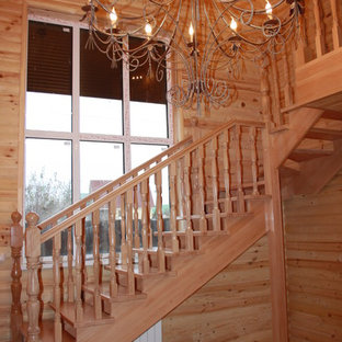 Inspiration for a mid-sized timeless painted l-shaped wood railing staircase remodel in Moscow with painted risers