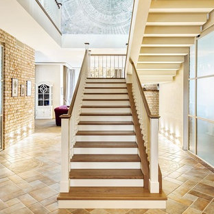 Large transitional wooden l-shaped wood railing staircase photo in Moscow with concrete risers