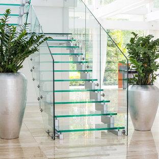 Modelo de escalera en U, contemporánea, de tamaño medio, sin contrahuella, con escalones de vidrio