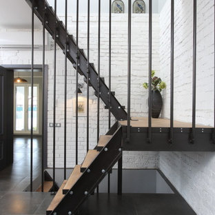 Urban wood u-shaped staircase in Moscow with open risers.