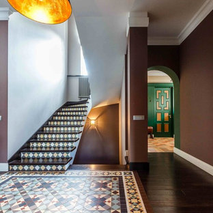 Inspiration for a mid-sized eclectic painted u-shaped staircase remodel in Other with tile risers