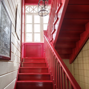Inspiration for a mid-sized eclectic painted u-shaped staircase remodel in Moscow with painted risers