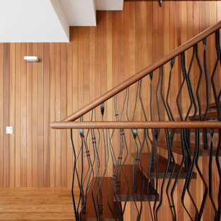 Contemporary wood u-shaped staircase in Moscow with wood risers.