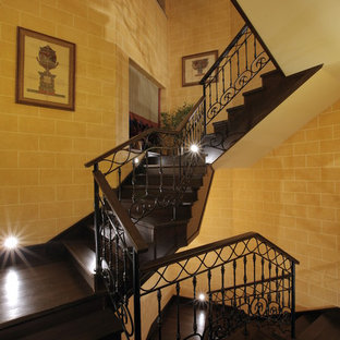 This is an example of a mediterranean wood l-shaped staircase in Moscow with wood risers.