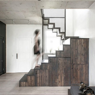 Staircase - small industrial painted metal railing staircase idea in Saint Petersburg with wooden risers