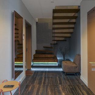 Пример оригинального дизайна: п-образная лестница в современном стиле без подступенок