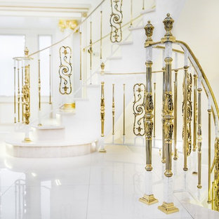 Large elegant marble curved metal railing staircase photo in Moscow with marble risers