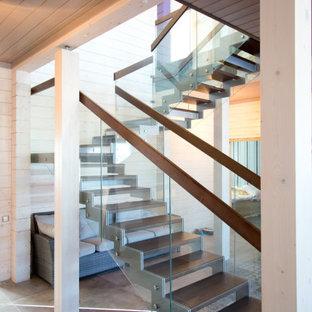 Пример оригинального дизайна: п-образная лестница в современном стиле с перилами из смешанных материалов без подступенок